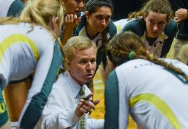 Jim Moore inspires his team before a match.