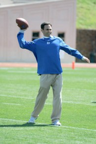 Wide Receiver coach Matt Lubick tossing the pigskin around
