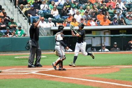 Shaun Chase comes around to score the second run for the Ducks.