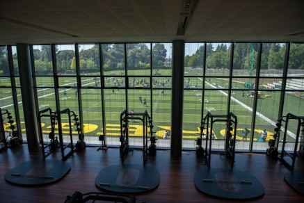 Weight training room in FPC overlooks practice fields