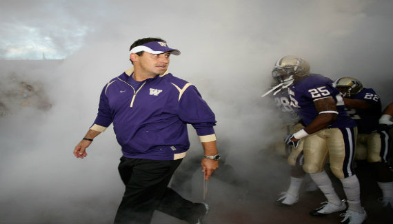 Steve Sarkisian running out of Seattle under the cover of fog