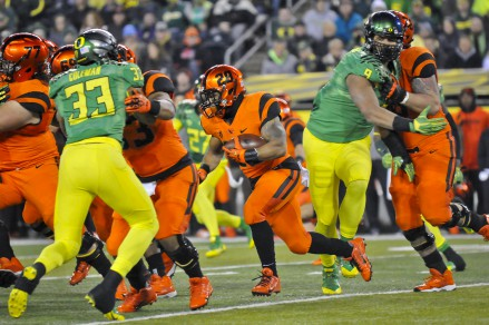 OSU's Terron Ward trying to run away from the Ducks.