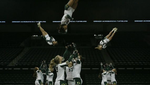 2013 acro team throwing full baskets at practice.