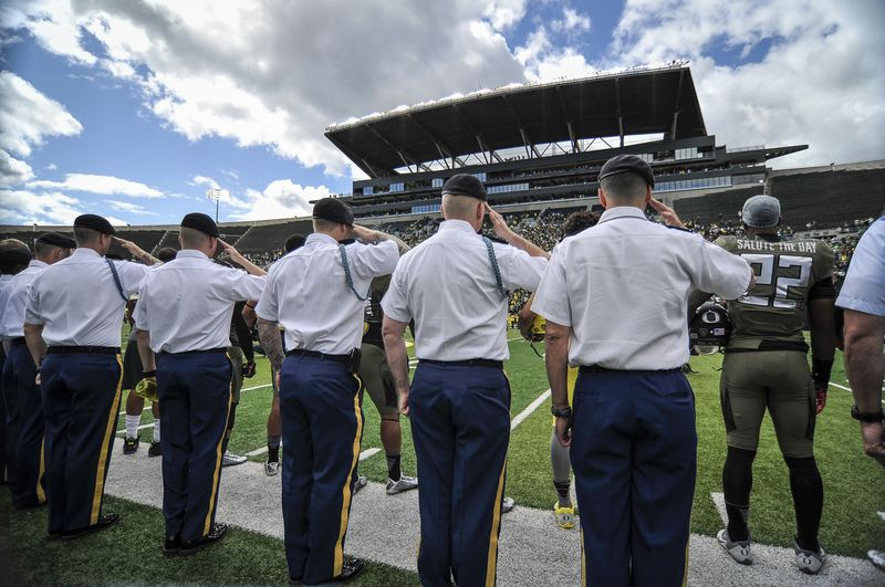 Troops salute as they are recognized by all at Autzen Stadium May 3rd, 2014.
