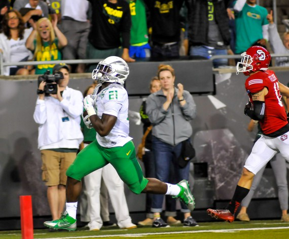 Royce Freeman runs for 26 yards on his second touchdown against South Dakota.