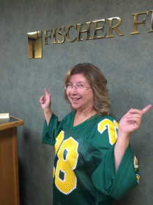 Charles' better half Lois models an authentic 80s jersey that must have shrunk since Charles can't fit into it anymore.