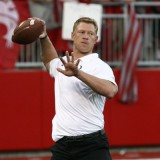 Scott Frost Tossing Football