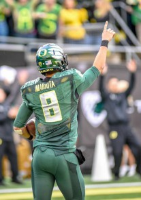 Heisman winner, Marcus Mariota, will try to help the Oregon Ducks get past Florida State in the Rose Bowl. A win for the Ducks would help the Pac 12 bowl record and worsen the ACC record.