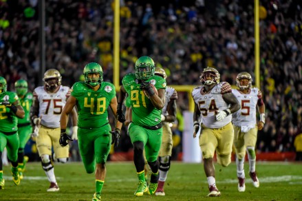 Tony Washington returns a fumble recovery for a touchdown in the Ducks' Rose Bowl semi-final victory over the Seminoles.