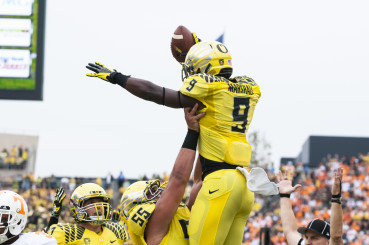 Byron Marshall celebrating a touchdown with his teammates