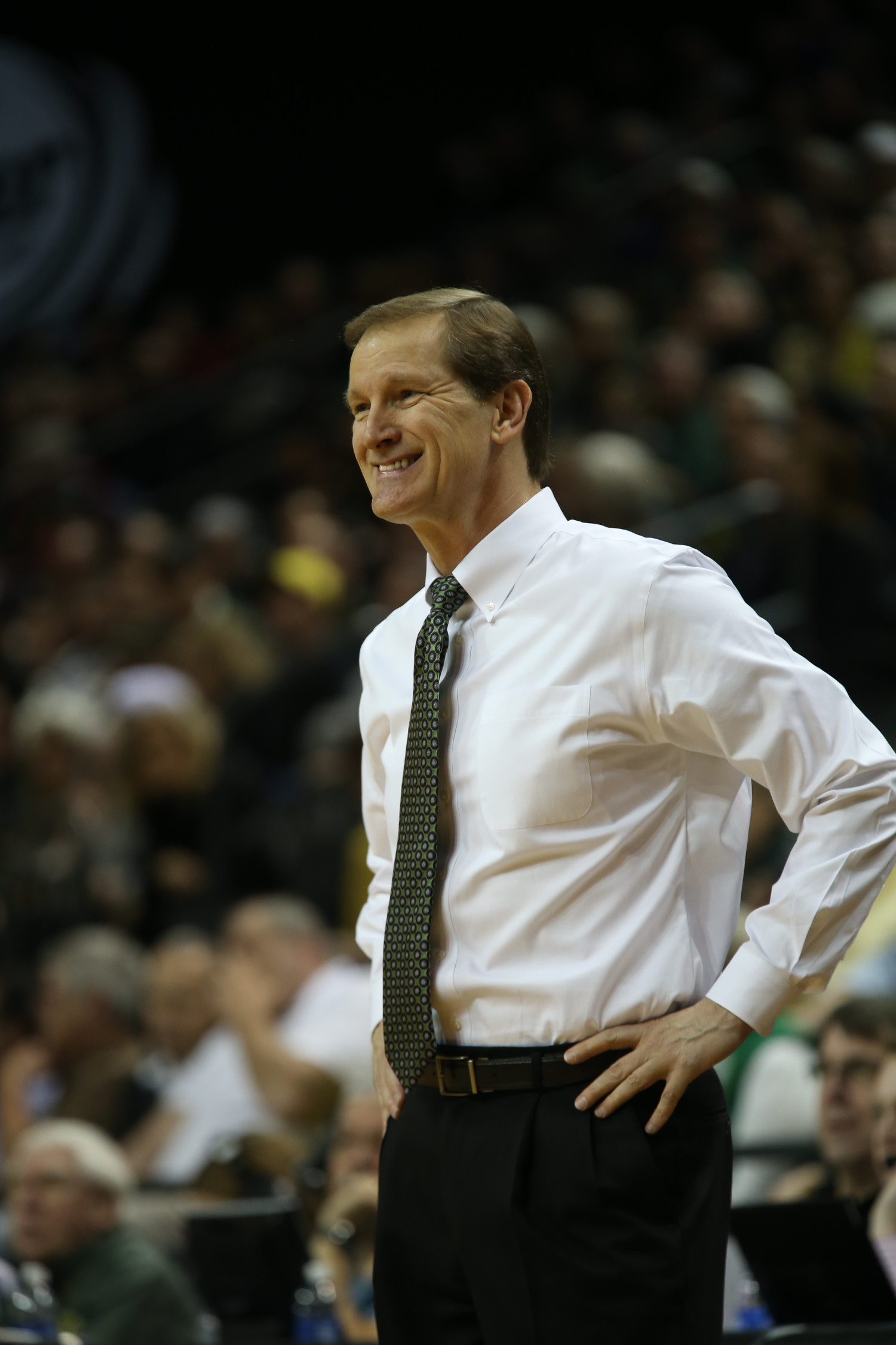Head coach Dana Altman does something he rarely does in a game: smiles.