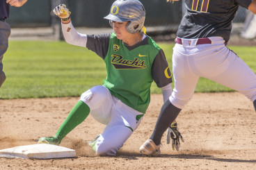Janie Takeda steals second base for her 95th stolen base. Takeda nearly tied  the Oregon career record for stolen bases (96).