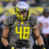 Oregon defeats Utah 44-21