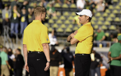 Coach Helfrich and Offensive Coordinator Scott Frost speaking together prior to the Oregon vs Washington game