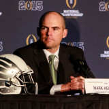 A focused Helfrich awaits a press conference at the National Championship game