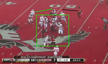 The quarterback is forced outside into the awaiting arms of the safety.