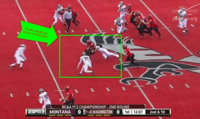 The running back is able to make a great gain of nine yards.