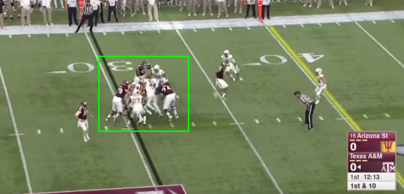 The defense swarms the running back for a gain of 2.