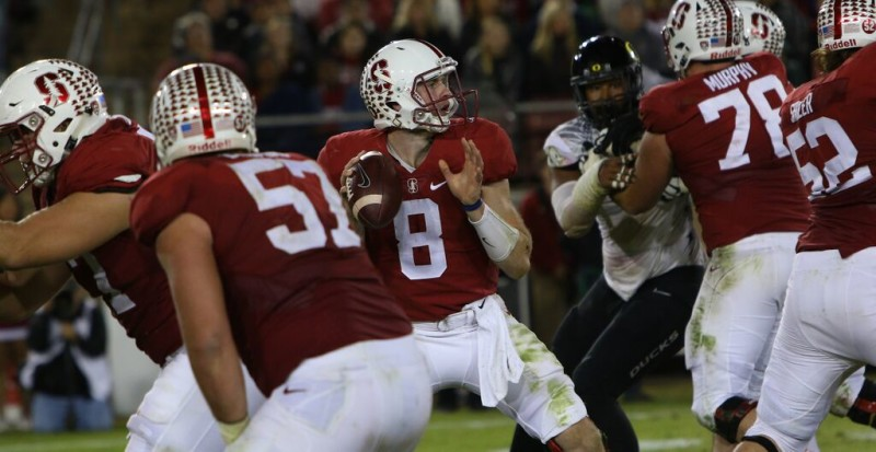 Stanford's Kevin Hogan, captured here in a rare moment of holding onto the ball.