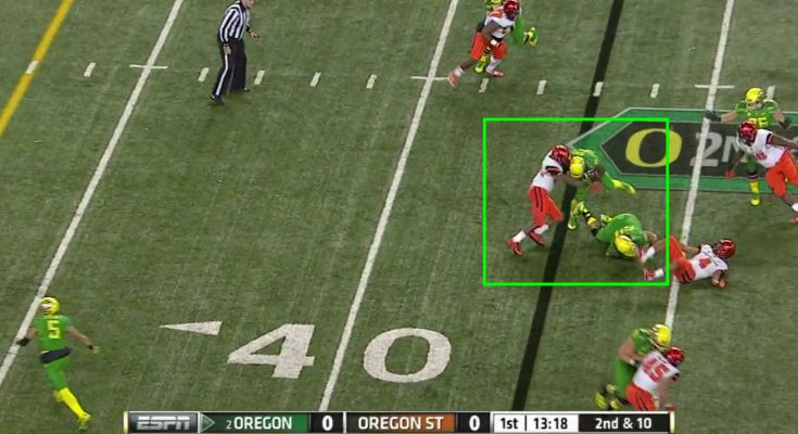 The running back has nowhere to go, and runs into the awaiting linebackers.