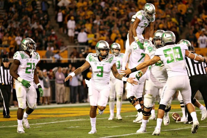 Vernon Adams and the Ducks celebrate a score in Thursday's 61-55 win over Arizona State.